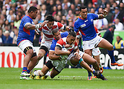 Japan centre Male Sau is tackled during the Rugby World Cup Pool B match between Samoa and Japan at stadium:mk, Milton Keynes, England on 3 October 2015. Photo by David Charbit.