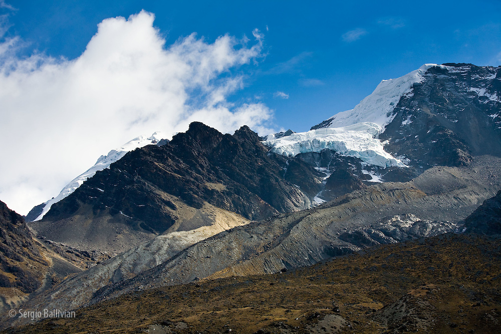 The glacier-covered summits of the Apolobamba Range are right next to the dirt road that winds its' way into and out of the westernmost Bolivian Andes.