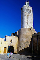 Children playing in front of a lighthouse converted to a mosque. El Jadida, previously known as Mazagan, is a port city on the Atlantic coast of Morocco.