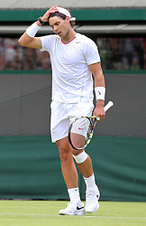 Dejected Rafael Nadal after losing in the first round on  the opening day of Wimbledon 2013 in <br /> London, Monday, 24th June 2013<br /> Picture by Stephen Lock / i-Images