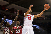 DALLAS, TX - NOVEMBER 25: Cannen Cunningham #15 of the SMU Mustangs drives to the basket against the Arkansas Razorbacks on November 25, 2014 at Moody Coliseum in Dallas, Texas.  (Photo by Cooper Neill/Getty Images) *** Local Caption *** Cannen Cunningham