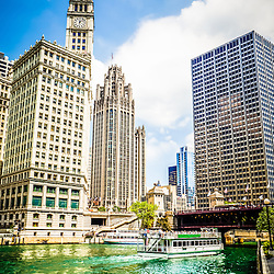 Chicago high quality picture with the Chicago River, tour boat, Wrigley building, Tribune Tower, and Equitable building.
