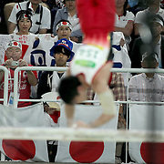 Gymnastics - Olympics: Day 5  Kohei Uchimura #154 of Japan in action watched by Japanese supporters during his routine on the Parallel Bars during the Artistic Gymnastics Men's Individual All-Around Final at the Rio Olympic Arena on August 10, 2016 in Rio de Janeiro, Brazil. (Photo by Tim Clayton/Corbis via Getty Images)