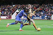 Karleigh Osborne of AFC Wimbledon and Mark Roberts (captain) of Cambridge United tussle during the Sky Bet League 2 match between Cambridge United and AFC Wimbledon at the R Costings Abbey Stadium, Cambridge, England on 2 January 2016. Photo by Stuart Butcher.