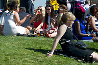National Hunt Horse Racing - 2017 Randox Grand National Festival - Saturday, Day Three [Grand National Day]<br /> <br /> Female racegoers relax in the sun after the  in the 1st race the 1.45 Gaskells Handicap Hurdle at Aintree Racecourse.<br /> <br /> COLORSPORT/WINSTON BYNORTH