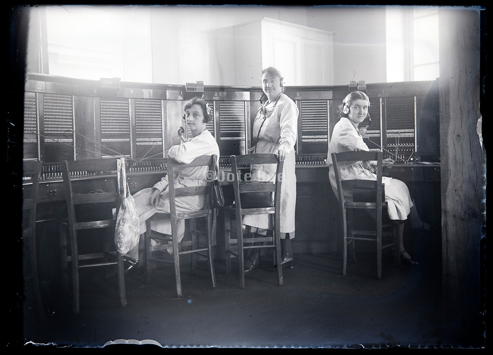 woman working on a phone switchboard at a  connection center France circa 1930s