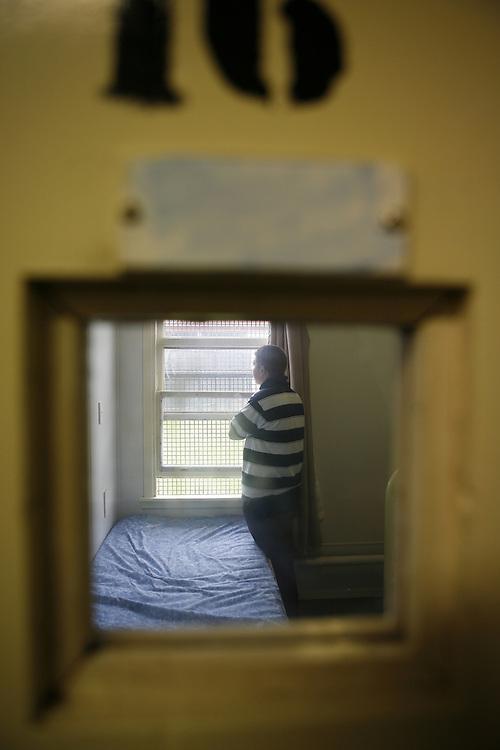 11/10/07 SW. Inside Arohata Women's Prison, Tawa. A prisoner looks hopefully out her window..Photo: Crispin Anderlini