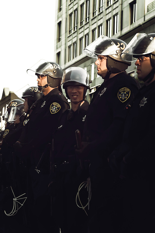 One officer enjoying moment at Oscar Grant demonstration in Oakland, CA.  Copyright 2010 Reid McNally.