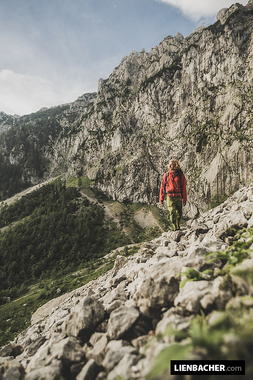 Mich Kemeter hikes to a new climbing route in the bavarian alps