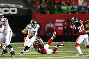 ATLANTA, GA - JANUARY 13: Russell Wilson #3 of the Seattle Seahawks tries to elude pressure from Kroy Biermann #71 of the Atlanta Falcons during the NFC Divisional Playoff Game at Georgia Dome on January 13, 2013 in Atlanta, Georgia. The Falcons defeated the Seahawks 30-28. (Photo by Joe Robbins) *** Local Caption *** Russell Wilson;Kroy Biermann