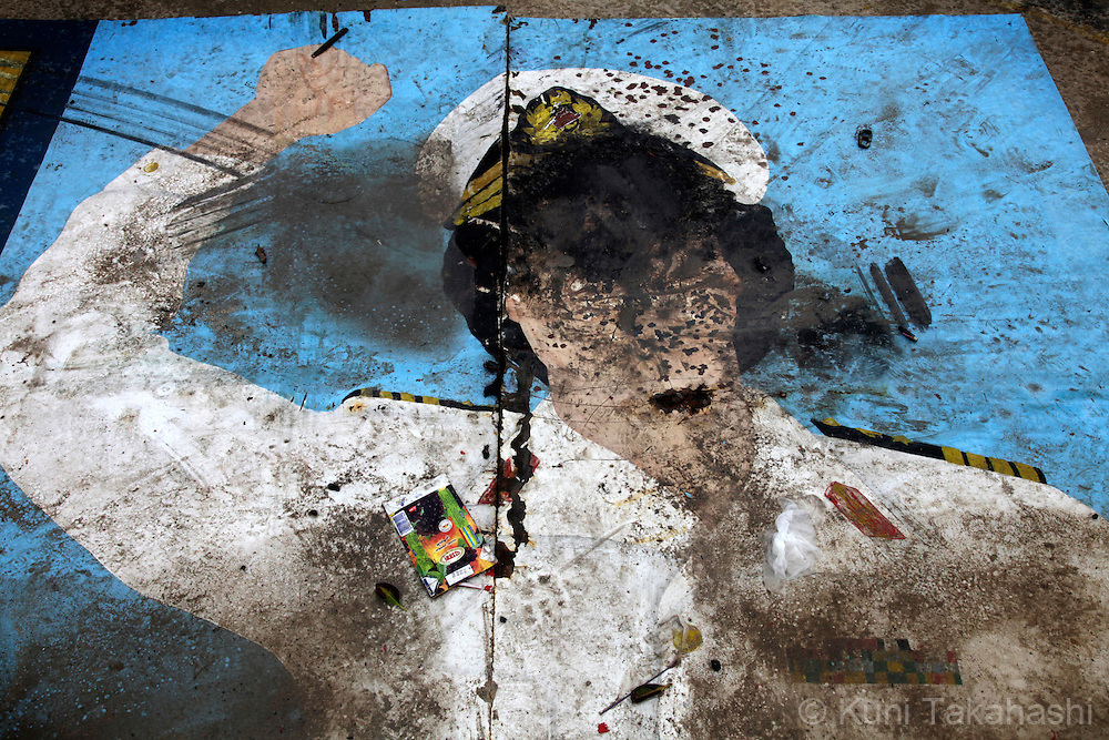 Vandalized mural of Col. Muammar Gaddafi is seen in Benghazi, Libya, on Feb 25, 2011 after the oppositions against Gaddafi took control of the city earlier this week. .Photo by Kuni Takahashi