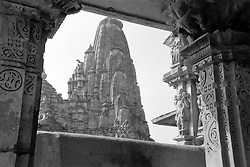 "India, Khajuraho,1999. A timeless view: level upon level of decoration culminates in a ""sikhara,"" or spire, in Khajuraho. The sheer erotic joy expressed in stone by these Chandela artisans is a wonder to behold."