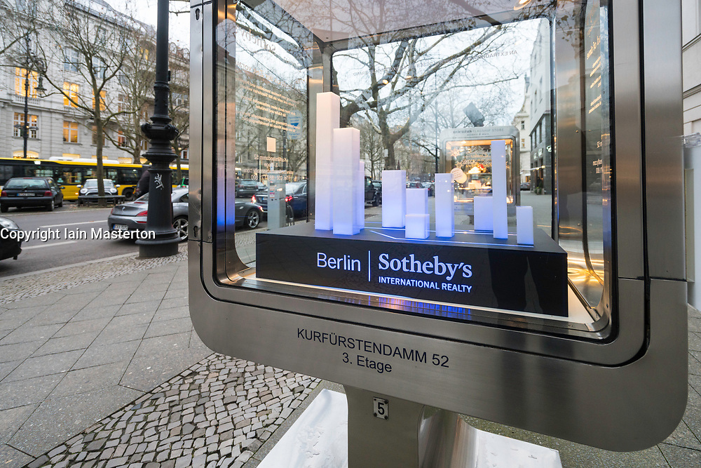 Sotheby's International Reality glass cabinet  on famous Kurfurstendamm shopping street in Berlin, Germany.