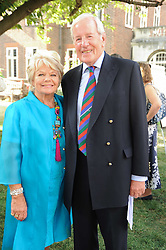JUDITH CHALMERS and NEIL DURDEN-SMITH at the Lord's Taverners Diamond Jubilee Garden Party held in College Gardens, Westminster Abbey, London on 8th July 2010.