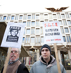 © Licensed to London News Pictures. 17/12/2011. LONDON, UK. Bradley Manning supporters stand outside the US Embassy during a protest in London today. The protest, taking place on Manning's 24th birthday, called for his release from custody in the US where he is being held for leaking 720,000 diplomatic and military documents to website Wikileaks. Photo credit: Matt Cetti-Roberts/LNP