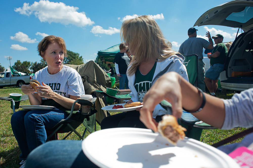 "Debbie Lewinski (left) and her daughter Emily Lewinski (center) talk over hamburgers during the pre-game tailgate party on saturday. ""It gives you the spirit of OU"", Debbie Lewinski said, ""I went to OSU but after this tailgating party I love OU."" Photo by: Ross Brinkerhoff."