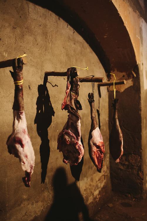Iberico pig legs hang at Finca Al Cornocal, Extramadura (Barajoz Province), Spain.