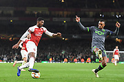 Arsenal Midfielder Ainsley Maitland-Niles (15) and Sporting Lisbon Forward Nani (17) during the Europa League group stage match between Arsenal and Sporting Lisbon at the Emirates Stadium, London, England on 8 November 2018.