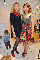 Left to right, NATALIA VODIANOVA and EVA KARAYIANNIS at the launch of the Natalia Dress, inspired by Natalia Vodianova to benefit her Naked Heart Foundation held at Caramel Baby&Child, 77 Ledbury Road, London W11 on 16th May 2012.