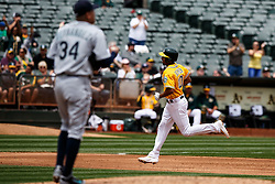 OAKLAND, CA - MAY 04: Marcus Semien #10 of the Oakland Athletics rounds the bases after hitting a home run off of Felix Hernandez #34 of the Seattle Mariners during the third inning at the Oakland Coliseum on May 4, 2016 in Oakland, California. (Photo by Jason O. Watson/Getty Images) *** Local Caption *** Marcus Semien; Felix Hernandez