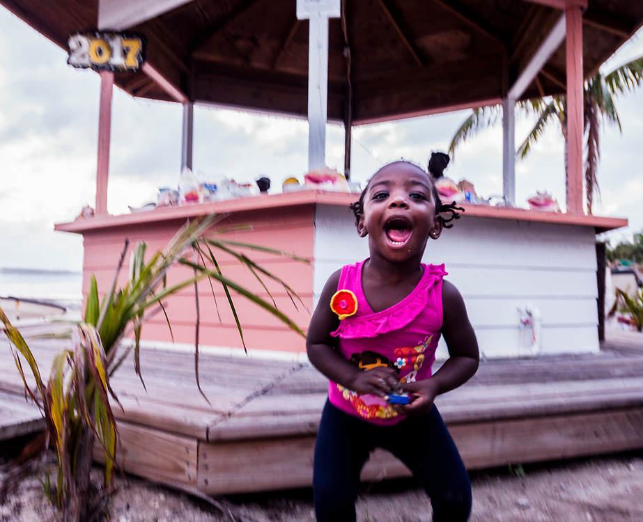The daughter of a restaurateur that specialises in conch dishes plays near the ocean-front establishment. Both of her parents are fully invested in this business and if conch run out, her life would change.