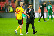Watford midfielder Will Hughes (19) goes to shake the Watford Manager Sanchez Flores hand at full time during the Premier League match between Watford and Bournemouth at Vicarage Road, Watford, England on 26 October 2019.