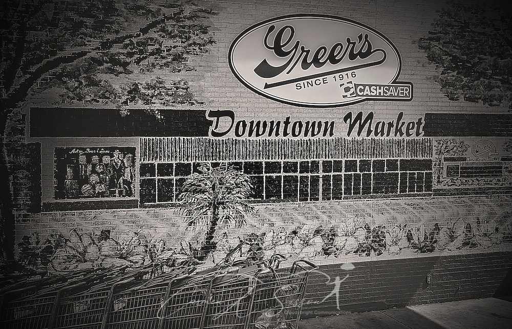 A mural adorns the front wall of Greer's grocery store, July 30, 2016, in Mobile, Alabama. The mural, along with another on the Broad Street side, was painted by local artists Devlin Wilson and Shelley Ingersoll of Innova Arts. The murals tell the story of the store's history, which was founded in Mobile in 1916. (Photo by Carmen K. Sisson/Cloudybright)
