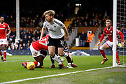 Fulham defender Tim Ream (13) ends up with the ball after a goal mouth scramble during the EFL Sky Bet Championship match between Fulham and Barnsley at Craven Cottage, London, England on 23 December 2017. Photo by Andy Walter.