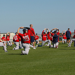 February 19, 2011; Fort Myers, FL, USA; Boston Red Sox players stretch during spring training at the Player Development Complex.  Mandatory Credit: Derick E. Hingle