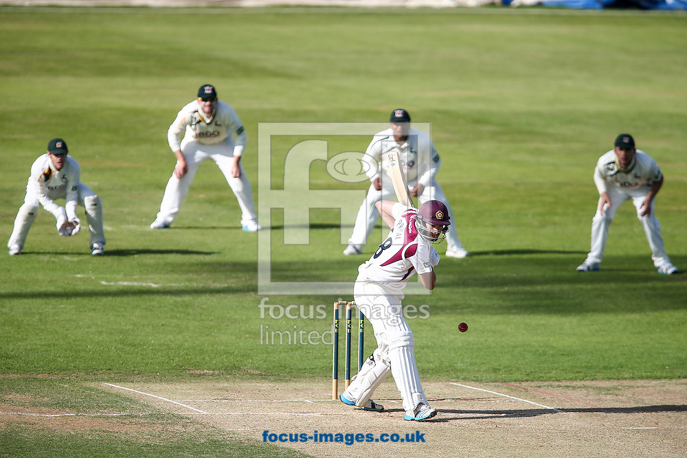 Matthew Spriegel of Northamptonshire County Cricket Club (centre)  leaves the ball as the Nottinghamshire players look on during the LV County Championship Div One match at the County Ground, Northampton.<br /> Picture by Andy Kearns/Focus Images Ltd 0781 864 4264<br /> 17/08/2014