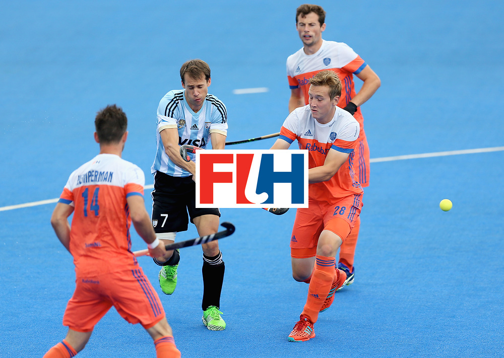 LONDON, ENGLAND - JUNE 25: Facundo Callioni of Argentina attempts a shot under pressure from Floris Wortelboer of the Netherlands during the final match between Argentina and the Netherlands on day nine of the Hero Hockey World League Semi-Final at Lee Valley Hockey and Tennis Centre on June 25, 2017 in London, England. (Photo by Steve Bardens/Getty Images)