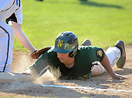 LANGHORNE, PA - JUNE 27:  Yardley Western first baseman Kyle Marshall attempts to tag out Newtown's Chase D'Arcangelo during the Newtown vs. Yardley Western Legion baseball game at Cairn University June 27, 2014 in Langhorne, Pennsylvania.  (Photo by William Thomas Cain/Cain Images)