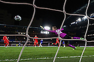 Simon Mignolet of Liverpool makes a save during the Capital One Cup Semi Final 2nd Leg match between Chelsea and Liverpool at Stamford Bridge, London, England on 27 January 2015. Photo by David Horn.