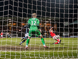 Ross County's Craig Curran scoring their goal past Dundee's keeper Scott Bain. <br /> Dundee 1 v 1 Ross County, SPFL Premiership game player 4/1/2015 at Dundee's home ground Dens Park.