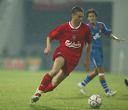 BANGKOK, THAILAND - Thailand. Thursday, July 24, 2003: Liverpool's Anthony Le Tallec in action against Thailand during a preseason friendly match at the Rajamangala National Stadium. (Pic by David Rawcliffe/Propaganda)