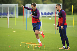 4 October 2017 -  2018 FIFA World Cup Qualifying (Group F) - England Training - Harry Winks jumps over training bars as Kieran Trippier looks on - Photo: Marc Atkins/Offside