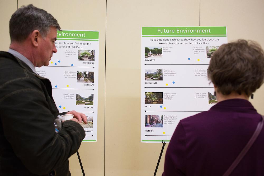 Athens Mayor Steve Patterson, left, and Dianne Bouvier read a board about the future environment of Park Place at the public planning workshop at the Athens Community Center on Feb. 22, 2017.
