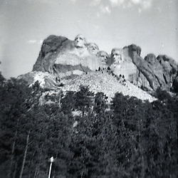 Summer 1967:  Mt Rushmore Monument outside Rapid City South Dakota..Image taken by a pre-teen boy during the year listed in caption,  scanned and adjusted in PhotoShop.  Image was shot with a Kodak Hawkeye 126 Instamatic camera..