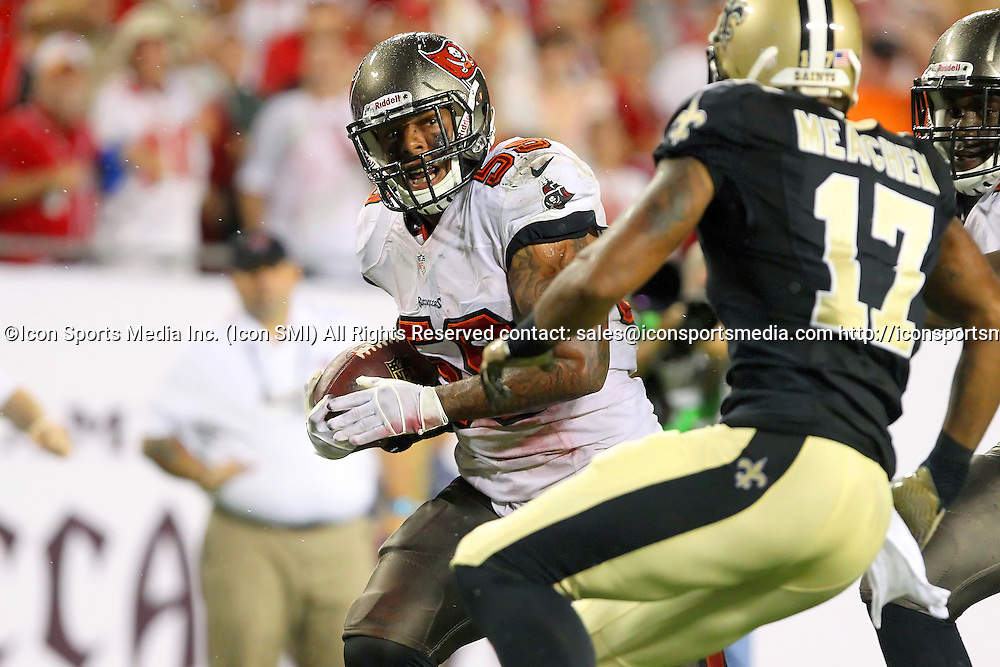 15 SEP 2013:    Mason Foster (59) of the Buccaneers intercepts a pass from Drew Brees of the Saints and returns the pass for a touchdown during the NFL regular season game between the New Orleans Saints and the Tampa Bay Buccaneers at Raymond James Stadium in Tampa, Florida.