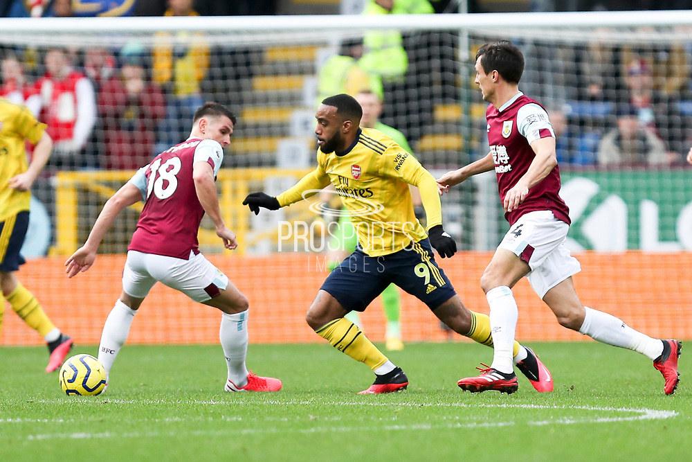 Arsenal forward Alexandre Lacazette goes passed two Burnley defenders  during the Premier League match between Burnley and Arsenal at Turf Moor, Burnley, England on 2 February 2020.