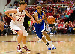 December 15, 2009; Stanford, CA, USA;  Duke Blue Devils guard Jasmine Thomas (5) dribbles past Stanford Cardinal guard Jeanette Pohlen (23) during the first half at Maples Pavilion.