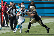 Christian McCaffrey(22) is forced out of bounds by Alex Anzalone(47) in the New Orleans Saints 34 to 13 victory over the Carolina Panthers.