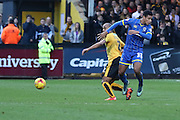 Lyle Taylor of AFC Wimbledon and Elliot Omozusi of Exeter City during the Sky Bet League 2 match between Cambridge United and AFC Wimbledon at the R Costings Abbey Stadium, Cambridge, England on 2 January 2016. Photo by Stuart Butcher.