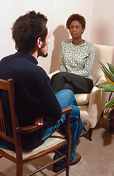 Client talking to counsellor during counselling session,