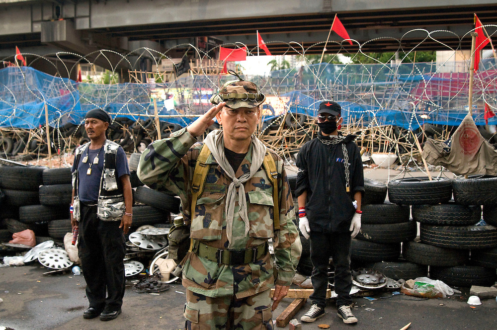 "Major General Khattiya Sawasdipol, also known as Seh Daeng at the Red Shirt front line encampment boarding Silom Road, Bangkok, Thailand, on April 28, 2010.  He is aligned with the United Front for Democracy against Dictatorship (UDD) which has occupied the Bangkok central shopping district demanding dissolution of the current government led by Abhisit Vejjajiva.  Seh Daeng has his own political party called ""Khatiyatham Party."""