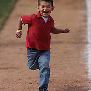 Children running the bases at the end of the game after the Bridgeport Bluefish V York Revolution, Atlantic League, Minor League ballgame at Harbor Yard Ballpark, Bridgeport, Connecticut, USA. Photo Tim Clayton