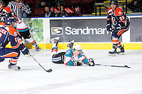 KELOWNA, CANADA, FEBRUARY 11: Zach Franko #9 of the Kelowna Rockets reaches for the puck as the Kamloops Blazers visit the Kelowna Rockets on February 11, 2012 at Prospera Place in Kelowna, British Columbia, Canada (Photo by Marissa Baecker/Shoot the Breeze) *** Local Caption ***
