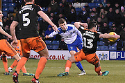 Bury Midfielder, Scott Burgess (20) ahoots and blocked by Sheffield United Defender, Jake Wright (13)  during the EFL Sky Bet League 1 match between Bury and Sheffield Utd at the JD Stadium, Bury, England on 2 January 2017. Photo by Mark Pollitt.