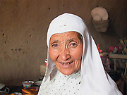 Old woman smiling in Wudaolinzi Village near Tongxin. Ningxia Province, China.