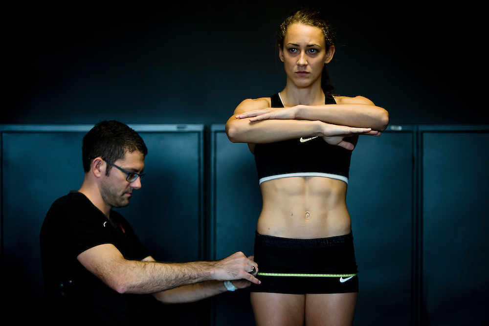 Trent Stellingwerff, applied sport physiologist with a specialization in performance nutrition performs anthropometric measurements on Samantha Murphy at the Pacific Institute for Sport Excellence on December 3rd 2015 in Victoria, British Columbia Canada.